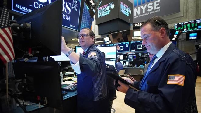 Dow rises following changes in benchmark